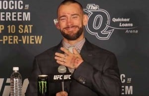 cm-punk-hand-on-chest-smile