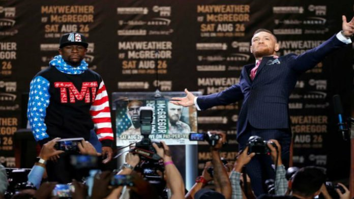 Conor McGregor Sends Hidden Message In Pinstripe Suit