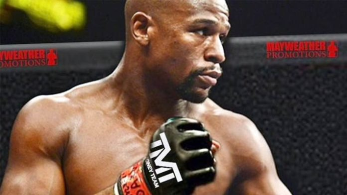 Floyd Mayweather says he's starting MMA training with UFC champ Tyron Woodley